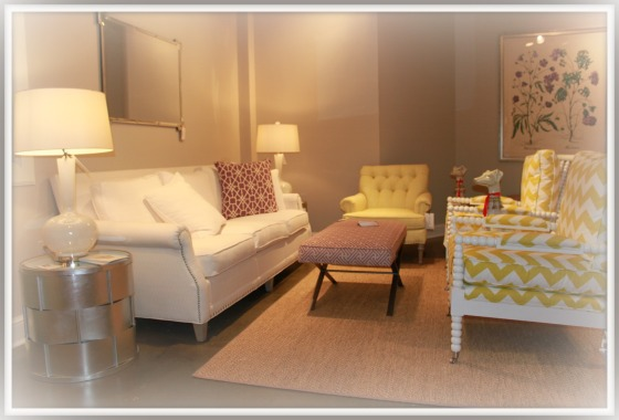 Nailhead trim and spool turned legs and frame on chair both very popular styles at Spring 2013 market. These by CRLaine.