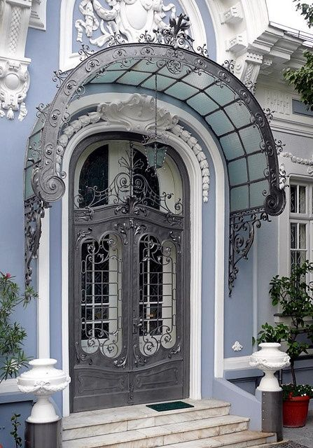 Awning wrought iron scrollwork